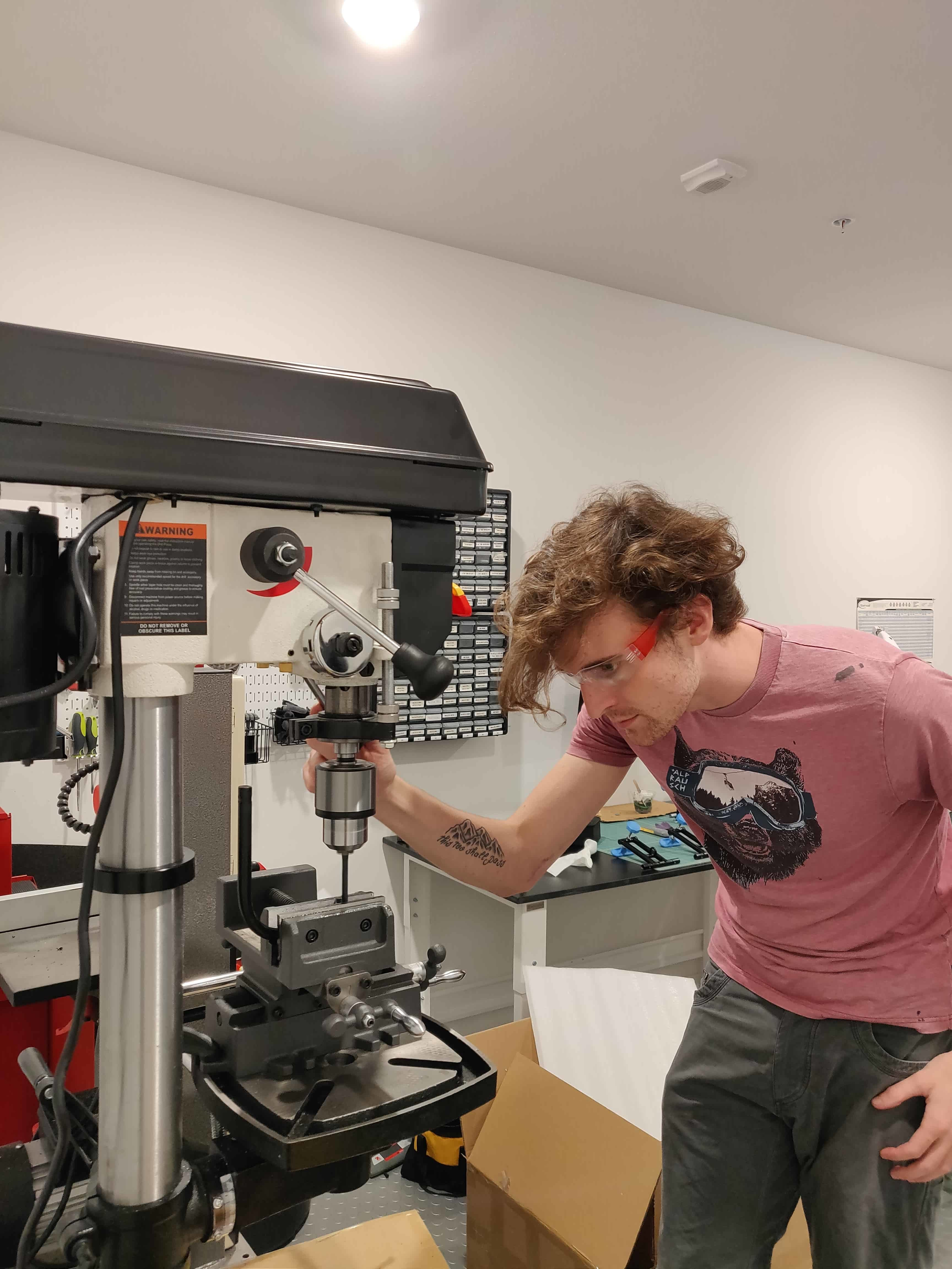 Thompson working with the drill press