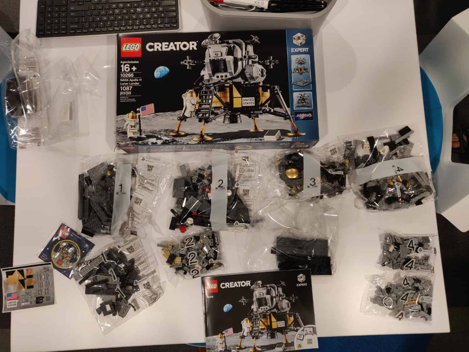 Lego lunar lander parts laid out in bags